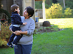 Marlene Feltner holding her grandson Braxton at her farmhouse in Wendover, Ky., on Friday, October, 11, 2013. He ran around and played on the farm all afternoon. Photo by Rachel Walker