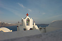 Oia, Santorini, Greece. 08.05.2014. Whitewashed rooftops and church bell tower in the village of Oia. Photograph © Jane Hobson.