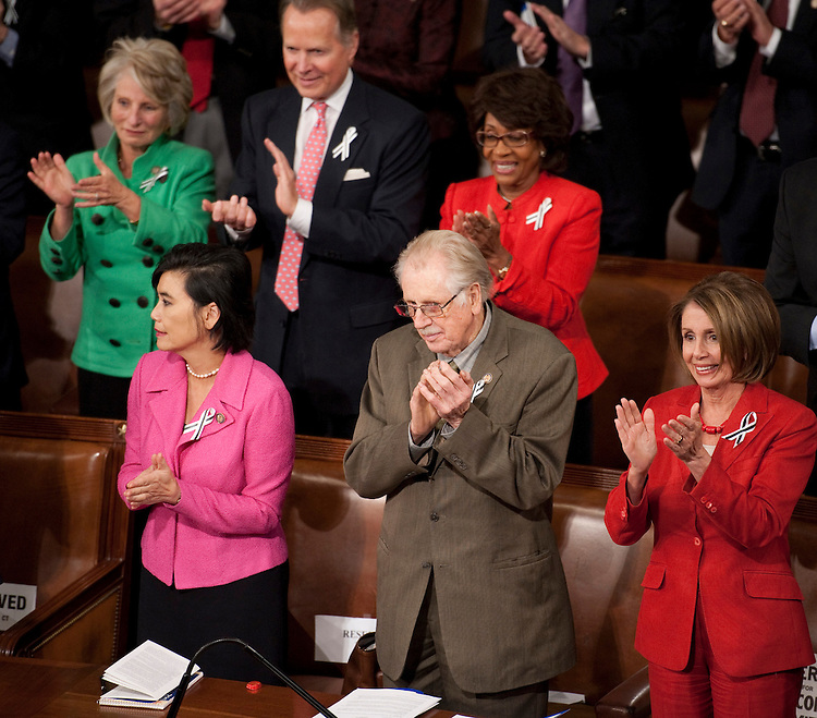 WASHINGTON, DC- Jan. 25: Front row: Rep. Judy Chu, D-Calif., Rep. Roscoe G. Bartlett, R-Md., and House Minority Leader Nancy Pelosi, D-Calif., during  President Barack Obama's State of the Union address to a joint session of the U.S. Congress. In the wake of the Jan. 8 shootings in Tucson, Ariz., that wounded Rep. Gabrielle Giffords (D-Ariz.), there has been a push for lawmakers to break from the tradition of partisan seating at the State of Union address. In the back row are Rep. Jane Harman, D-Calif., Rep. David Dreier, R-Calif., and Rep. Maxine Waters, D-Calif. (Photo by Scott J. Ferrell/Congressional Quarterly)