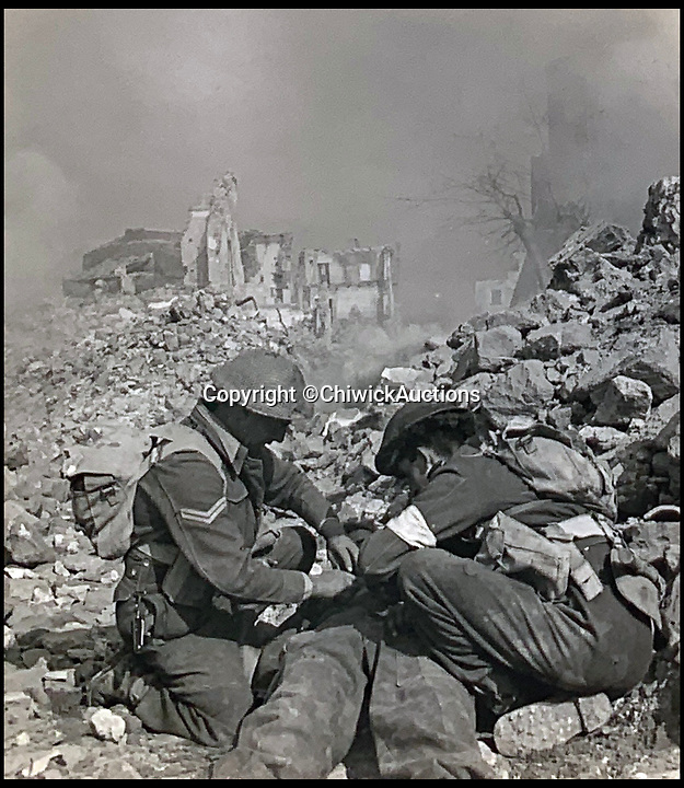 BNPS.co.uk (01202 558833)<br /> Pic:  ChiswickAuctions/BNPS<br /> <br /> Allies tend to a wounded comrade at Monte Cassino.<br /> <br /> Remarkable previously unseen photos documenting the momentous closing stages of World War Two and its historic aftermath have come to light.<br /> <br /> They were taken by Sergeant Charles Hewitt, of the Army Film and Photographic Unit, who later went on to work for the Picture Post and the BBC.<br /> <br /> He was present at many of the important offensives of 1944 and '45 including the Battle of Monte Cassino during the Italian Campaign and the Allies advance into Germany following the D-Day invasion.