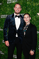 NEW YORK, NY - DECEMBER 4: Brian Kelly and  Adam Rippon  at the Inaugural TPG Awards Ceremony at the Intrepid Sea-Air-Space Museum on December 4, 2018 in New York City. <br /> CAP/MPI99<br /> &copy;MPI99/Capital Pictures