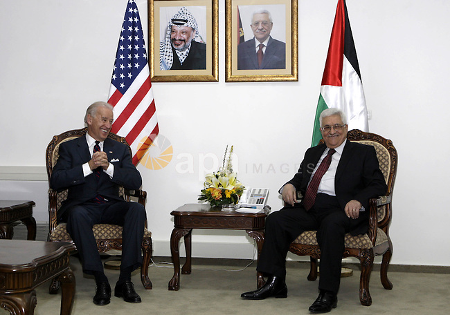 U.S. Vice President Joseph Biden sits with Palestinian President Mahmoud Abbas during their meeting in the West Bank city of Ramallah, Wednesday, March 10, 2010. Israel's new plan to build 1,600 homes for Jews in Palestinian-claimed east Jerusalem overshadowed Biden's visit to the West Bank on Wednesday. Biden held talks with Palestinian President Mahmoud Abbas and Prime Minister Salam Fayyad, in part to ease their doubts about the latest U.S. peace efforts. Photo by Thaer Ganaim