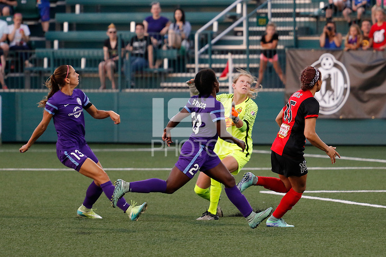 Rochester, NY - Saturday June 11, 2016: Orlando Pride forward Alex Morgan (13) and Western New York Flash goalkeeper Britt Eckerstrom (28) watch a shot go over the crossbar during a regular season National Women's Soccer League (NWSL) match between the Western New York Flash and the Orlando Pride at Rochester Rhinos Stadium.