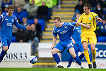 St Johnstone v Hibs...02.10.10  .Andy Jackson fends off Kevin McBride.Picture by Graeme Hart..Copyright Perthshire Picture Agency.Tel: 01738 623350  Mobile: 07990 594431