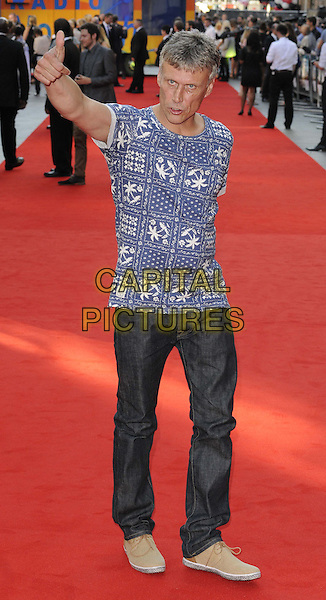 Mark &quot;Bez&quot; Berry<br /> attended the &quot;Alan Partridge: Alpha Papa&quot; UK film premiere, Vue West End cinema, Leicester Square, London, England, UK, <br /> 24th July 2013.<br /> full length hand waving blue t-shirt print jeans  <br /> CAP/CAN<br /> &copy;Can Nguyen/Capital Pictures