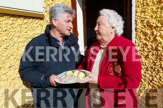 James Hussey delivering Meals on Wheels to Mary O'Flynn, Rae Street, Tralee on Wednesday morning last.
