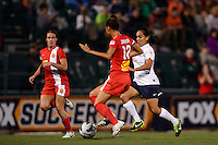Sky Blue FC forward Monica Ocampo (8) is marked by Western New York Flash defender Estelle Johnson (12). The Western New York Flash defeated Sky Blue FC 2-0 during a National Women's Soccer League (NWSL) semifinal match at Sahlen's Stadium in Rochester, NY, on August 24, 2013.