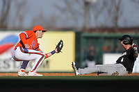 Clemson Tigers second baseman Steve Wilkerson #17 tags out a hard sliding Connor Bright #4 during a game against the South Carolina Gamecocks at Fluor Field on March 1, 2014 in Greenville, South Carolina. The Gamecocks defeated the Tigers 10-2. (Tony Farlow/Four Seam Images)