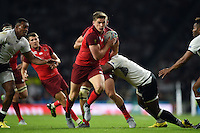 Owen Farrell of England takes on the Fiji defence. Rugby World Cup Pool A match between England and Fiji on September 18, 2015 at Twickenham Stadium in London, England. Photo by: Patrick Khachfe / Onside Images