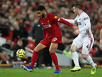 2nd January 2020; Anfield, Liverpool, Merseyside, England; English Premier League Football, Liverpool versus Sheffield United; Trent Alexander-Arnold of Liverpool shields the ball from John Fleck of Sheffield United - Strictly Editorial Use Only. No use with unauthorized audio, video, data, fixture lists, club/league logos or 'live' services. Online in-match use limited to 120 images, no video emulation. No use in betting, games or single club/league/player publications