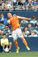 Andrew Driver (20) midfield Houston Dynamo stops the ball from going out of play..Sporting Kansas City and Houston Dynamo played to a 1-1 tie at Sporting Park, Kansas City, Kansas.