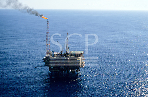 Rio de Janeiro coast, Brazil. Petrobras offshore oil platform PGP-1 in the Campos Basin showing gas flare-off.