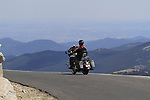 Caucasian motorcyclist on the Mount Evans highway in the Rocky Mountains west of Denver, Colorado, USA Private photo tours to Mt Evans.