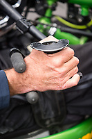 Morehead City, NC -- Paul Kelly has limited use of his fingers, so custom handles that grip his wrists allow him to push and pull with his wrists.  Quadriplegic hand cyclist Paul Kelly, 62, trains for the Boston Marathon Tuesday, March 27, 2018. (Justin Cook for The Wall Street Journal)<br /> <br /> SUMMARY:<br /> <br /> Paul Kelly, hand cyclist, Beaufort, NC Training for the Boston Marathon so we would want to shoot in March to run the week before the marathon or marathon Monday, Apriln16. Life as a quadriplegic doesn't keep 62-year-old Paul Kelly on the sidelines. After breaking his neck in a swimming accident in 1978, Kelly was determined to find fitness activities to maintain an active lifestyle. He discovered handcycles while watching his niece compete in the 2006 Marine Corps Marathon and was inspired to start his own marathon career to stay fit. Paul has competed in over 100 half and full marathons. On April 16, he will celebrate his 40th year of living as a quadriplegic by taking on one of the most coveted races for a marathoner -- the Boston Marathon. Kelly is among the 60 handcyclists competing in the 2018 Boston Marathon with a qualifying time of 1:26:37. Most of Paul's distance training takes place at Bogue Banks, which includes Atlantic Beach, Salter Path, and Emerald Isle, N.C. It's Nicholas Sparks worthy scenery with its marshes, waterways, inlets and small islands. Paul is particularly fond of the approach from Atlantic Beach to Bogue Banks -- it's via the high-rise bridge. In cold weather, Paul has to be mindful of the environment and dress in a manner that insulates his legs while also allowing his upper body to ventilate. Paul chooses to train at times of day when the temperatures are more reasonable. He uses hand warmers in his gloves, on the inside the grips on his handcycle and in the legs of his trousers.