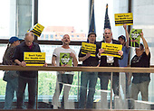 "Protestors chanting ""Healthcare is a right"" stage a sit-in outside the office of United States Senator Lisa Murkowski (Republican of Alaska) in the Hart Senate Office Building in Washington, DC on Wednesday, June 28, 2017.<br /> Credit: Ron Sachs / CNP"