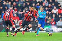 Jack Wilshere of Arsenal right holds off Lys Mousset of AFC Bournemouth during AFC Bournemouth vs Arsenal, Premier League Football at the Vitality Stadium on 14th January 2018