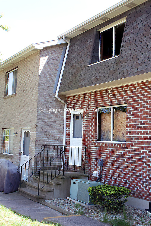 WATERBURY, CT- MAY 17  2011-051712DA13- Official clean up Thursday after a fatal fire at a Bucks Hill Road condominium complex Wednesday evening..Darlene Douty Republican American