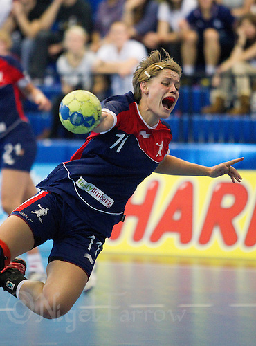 22 OCT 2011 - LONDON, GBR - Britain's Lyn Byl dives as she shoots during the Women's 2012 European Handball Championship qualification match against Russia at the National Sports Centre at Crystal Palace (PHOTO (C) NIGEL FARROW)