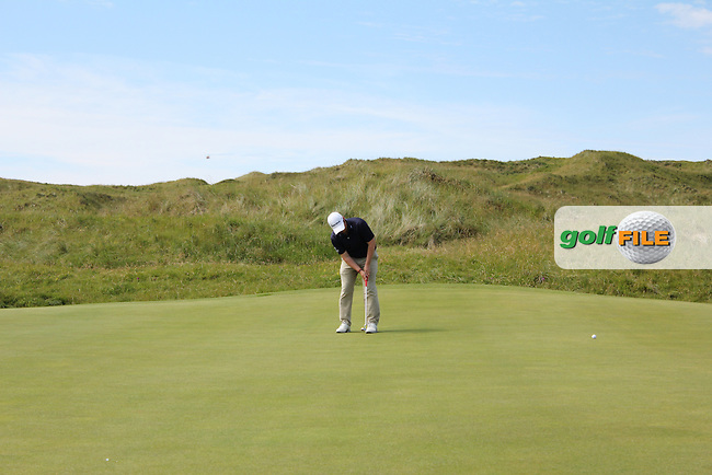 Gary Collins (Rosslare) on the 15th green during Matchplay Round 3 of the South of Ireland Amateur Open Championship at LaHinch Golf Club on Saturday 25th July 2015.<br /> Picture:  Golffile | TJ Caffrey