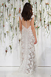 Model walks runway in a gown for the Watters Fall 2017 fashion show at The Knot COUTURE Show on April 23, 2017, during New York Bridal Fashion Week.