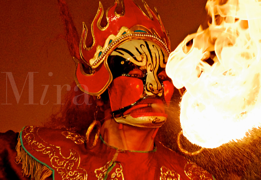 Fire-spitter at Sichuan Opera, Chengdu, China.
