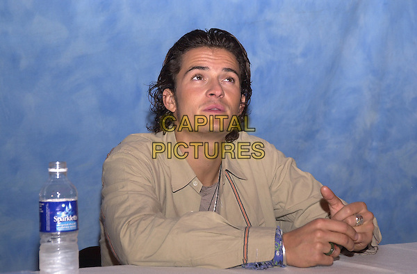 ORLANDO BLOOM.December 2003.half length rings funny face thinking looking up wrinkled forehead.www.capitalpictures.com.sales@capitalpictures.com.© Capital Pictures.