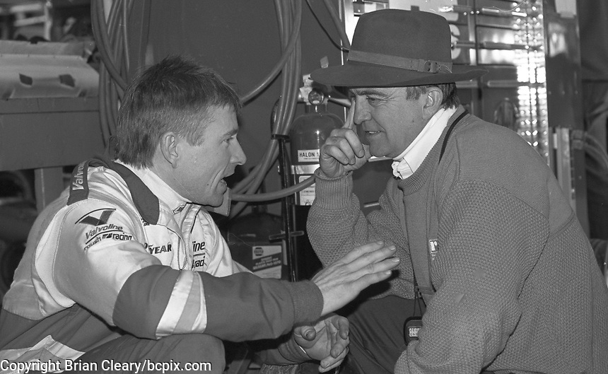 Mark Martin, left, and Jack Roush talk in the garage before the Daytona 500, Daytona International Speedway, Daytona Beach, FL, February 16, 1992. (Photo by Brian Cleary/www.bcpix.com)