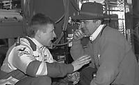 Mark Martin, left, and Jack Roush talk in the garage before the Daytona 500, Daytona International Speedway, Daytona Beach, FL, February 16, 1992. (Photo by Brian Cleary/www.bcpix.com)