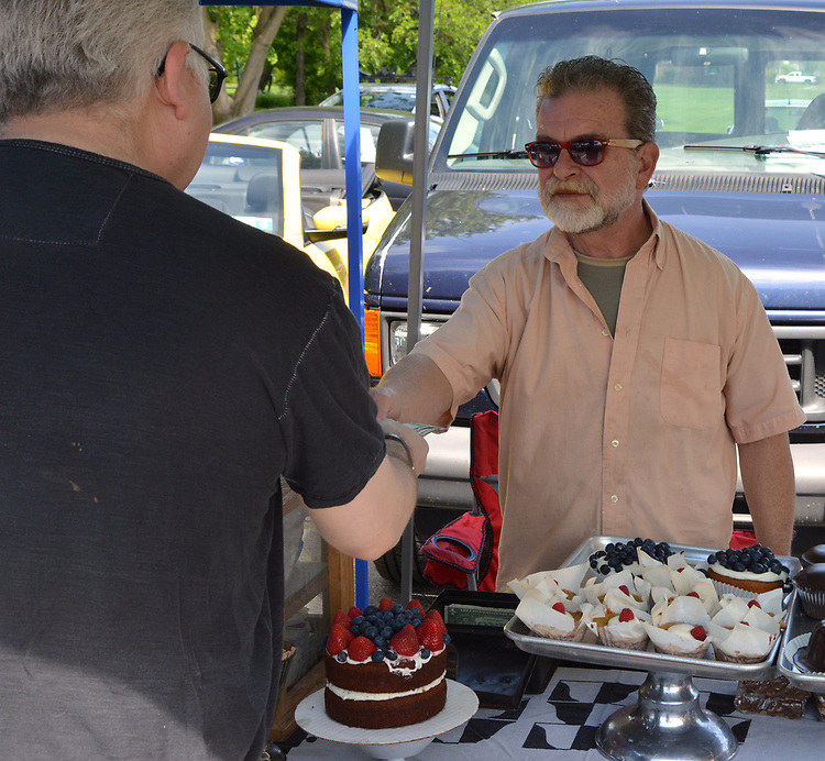 Bruce Coyle, owner of Sunporch Baked Goods, at his booth at the Opening Day of the 2017 Saugerties Farmer's Market on Saturday, May 27, 2017. Photo by Jim Peppler. Copyright/Jim Peppler-2017.