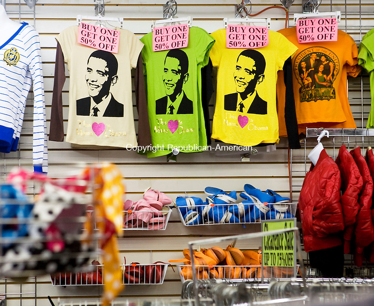 WATERBURY, CT - 26 JANUARY 2009 -012609JT03-<br /> Pres. Barack Obama t-shirt memorabilia hang on a wall of Top Notch clothing store on Bank Street in Waterbury on Monday. The store also sells calendars, watches, necklaces and pins with images of Pres. Obama.<br /> Josalee Thrift / Republican-American