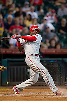 Philadelphia Phillies outfielder Domonic Brown #9 swings during the Major League baseball game against the Houston Astros on September 16th, 2012 at Minute Maid Park in Houston, Texas. The Astros defeated the Phillies 7-6. (Andrew Woolley/Four Seam Images).
