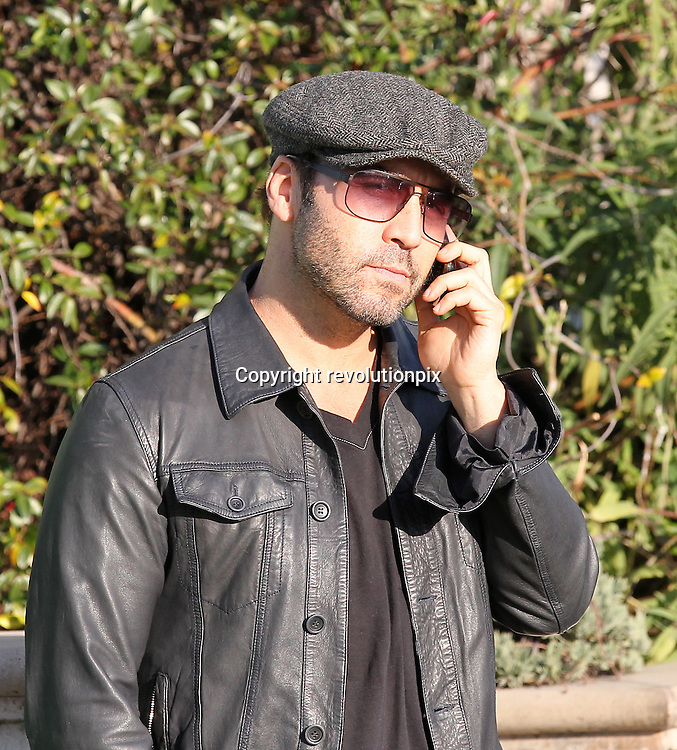 Jeremy Piven<br /> Los Angeles<br /> March 3 2011<br /> Jeremy Piven and an unidentified female friend, from Wisonsin ( car not pictured), at Urth Cafe on Main Street in Santa Monica<br /> Jeremy left driving a Lexus Hybrid LS sedan while talking on his phone<br /> ID revpix110303001