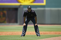 Umpire Raul Moreno handles the calls on the bases during the Carolina League game between the Lynchburg Hillcats and the Winston-Salem Rayados at BB&T Ballpark on June 23, 2019 in Winston-Salem, North Carolina. The Hillcats defeated the Rayados 12-9 in 11 innings. (Brian Westerholt/Four Seam Images)