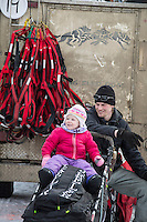 Dallas Seavey with his daughter sitting on his sled at the restart of the Iditarod sled dog race in Willow, Alaska Sunday, March 3, 2013.