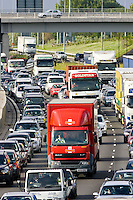 Royal Mail delivery truck slowed by traffic congestion on M25 motorway, near London, United Kingdom