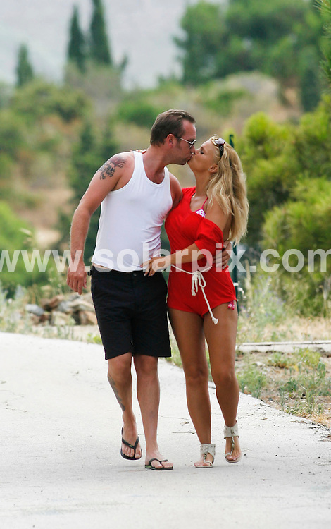 **ALL ROUND EXCLUSIVE PICTURES FROM SOLARPIX.COM**.**WORLDWIDE SYNDICATION RIGHTS**.Kerry Katona and new squeeze Adam Waldron enjoy a stroll in the countryside near their holiday home close to Marbella today. Kerry was in a playful mood as the couple enjoyed the sunshine but Adam was nursing a large hangover after joining in the festivities in a Spanish bar last night which saw Spain beat Germany to go through to the World Cup finals on Sunday..This pic: Kerry Katona and Adam Waldron.JOB REF:   11618    AB1       DATE:   08.07.10.**MUST CREDIT SOLARPIX.COM OR DOUBLE FEE WILL BE CHARGED**.**MUST AGREE FEE BEFORE ONLINE USAGE**.**CALL US ON: +34 952 811 768 or LOW RATE FROM UK 0844 617 7637**
