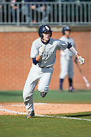 Ryan Miller (7) of the Florida Atlantic Owls hustles down the first base line against the Charlotte 49ers at Hayes Stadium on March 14, 2015 in Charlotte, North Carolina.  The Owls defeated the 49ers 8-3 in game one of a double header.  (Brian Westerholt/Four Seam Images)