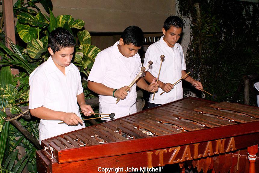 Young boys playing the marimba in Flores, El Peten, Guatemala.