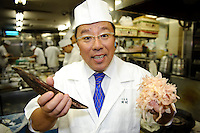 "Tamura Takashi, owner of ""Tsukiji Tamura"" Japanese restaurant, holding unprepared and shaved katsuobushi, Tokyo, Japan, July 17, 2009. Tsukiji Tamura is one of the best known ""ryotei"" traditional Japanese restaurants in Tokyo. Owner Tamura prepares dashi using two types of katsuobushi plus kombu from Hakodate in Hokkaido."