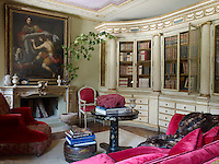 An 18th century Florentine pharmacy cabinet in the study displays antique books