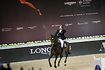 Marco Kutscher on Van Gogh celebrates winning Longines Grand Prixat the Longines Masters of Hong Kong on 21 February 2016 at the Asia World Expo in Hong Kong, China. Photo by Li Man Yuen / Power Sport Images