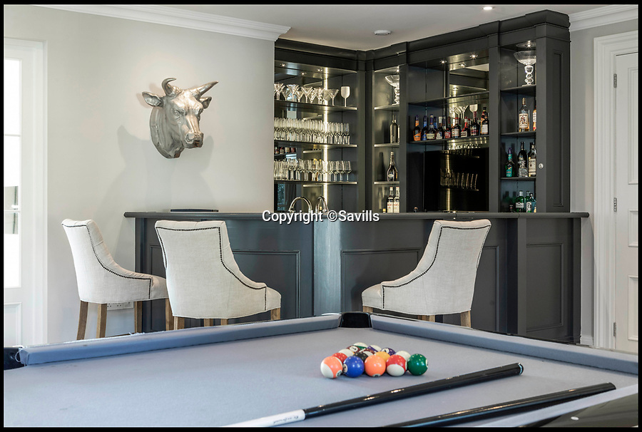 """BNPS.co.uk (01202 558833)<br /> Pic: Savills/BNPS<br /> <br /> Three-mendous!<br /> <br /> Pool table and bar.<br /> <br /> Stunning seaside estate overlooking Sandbanks that wouldn't look out of place in the Hollywood Hills - and you get three properties for your £9 million price tag.<br /> <br /> You get three luxury homes for the price of one with this spectacular private coastal estate - but they will still need deep pockets as the trio of properties are on the market for £8.995m.<br /> <br /> The Mulberry House Estate is in the leafy Canford Cliffs area of Poole, Dorset, and has a grand five-bedroom mansion, a second detached five-bedroom house and a two-bedroom gate house.<br /> <br /> Locals describe the Canford Cliffs area as the 'Hollywood Hills' of the coastal property hotspot, more refined and less showy than the more 'Malibu style' Sandbanks peninsula that it overlooks.<br /> <br /> Offering beautiful views but with privacy and seclusion, and without the tourist crowds that the Sandbanks millionaire's enclave attracts.<br /> <br /> Estate agent Savills say the sale is a """"unique opportunity"""" as the 2.2 acre Mulberry property is the only private estate in the area."""