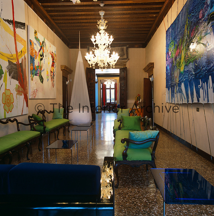The drawing room of this Venetian apartment in a Byzantine palazzo is dominated by the contemporary paintings of Michael Majerus and Fabian Marcaccio