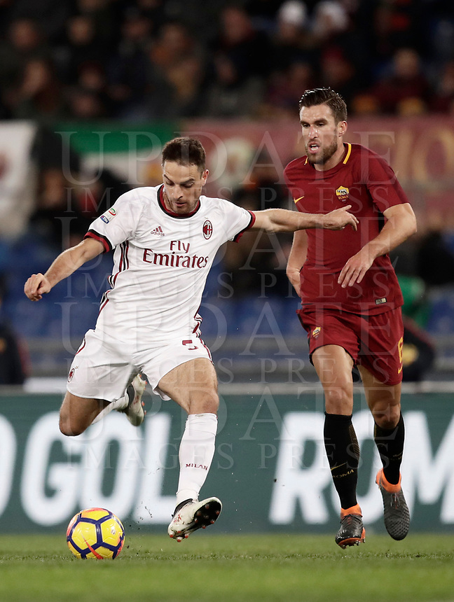Calcio, Serie A: AS Roma - AC Milan, Roma, stadio Olimpico, 25 febbraio, 2018.<br /> Milan's Giacomo Bonaventura (l) in action with Roma's Kevin Strootman (r) during the Italian Serie A football match between AS Roma and AC Milan at Rome's Olympic stadium, February 28, 2018.<br /> UPDATE IMAGES PRESS/Isabella Bonotto
