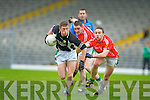 Jonathan Lyne Legion goes past Paul Kennedy and Damian Clifford Listry during the East Kerry semi final in Fitzgerald Stadium on Sunday