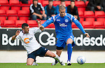 St Johnstone v Bolton....02.08.10  Pre-Season Friendly.Marcus Haber isfouled by Paul Robinson.Picture by Graeme Hart..Copyright Perthshire Picture Agency.Tel: 01738 623350  Mobile: 07990 594431