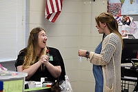 NWA Democrat-Gazette/CHARLIE KAIJO Rogers Public Education Foundation Board Member Amber Tallmadge-Scott (right) presents a grant award to teacher Ilonka Knowlton (left), Monday, May 13, 2019 at Heritage High School in Rogers.<br /><br />Members of the Rogers Public Education Foundation awarded over $172,000 in grants to teachers during surprise visits Monday. <br /><br />These grants will help fund many classroom needs that are beyond the schoolsÕ budgets including additional iPads, Chromebooks, video equipment, math tools, integrated movement opportunities, as well as supplies for literacy activities, science, art, physical education and music.