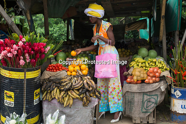 ABIDJAN, IVORY COAST – DECEMBER 6: A model for the Tunisian designer Fawzi Nawar is photographed in a market in Abidjan, Ivory Coast 2015 on December 6, 2015. (Photo by: Per-Anders Pettersson)