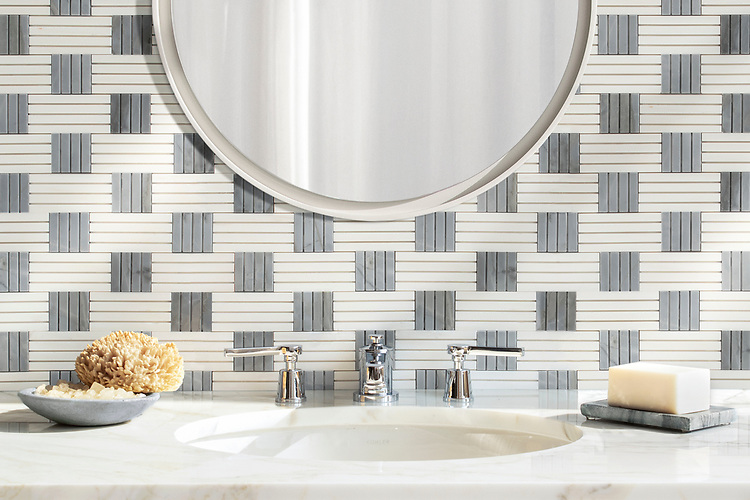 Kiawah Kente, a hand-cut stone mosaic, shown in polished Dolomite and Bardiglio. Designed by Joni Vanderslice as part of the J. Banks Collection for New Ravenna.