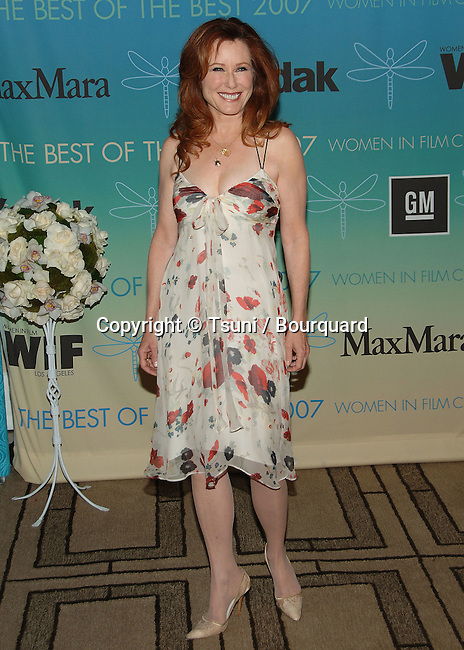 Mary McDonnell  arriving at the Women in Film ( WIF ) Crystal and Lucy Awards at the Beverly Hilton in Los Angeles.<br /> <br /> full length<br /> smile<br /> white printed dress
